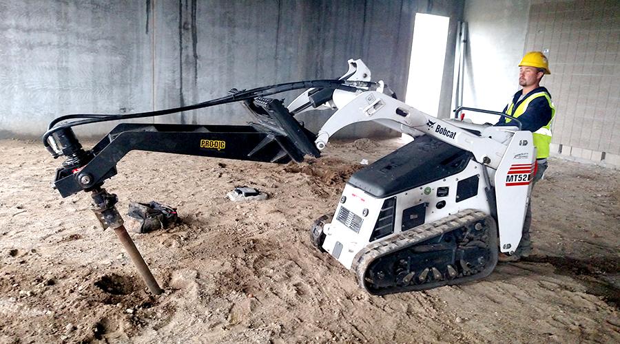 Man on bobcat - foundation work