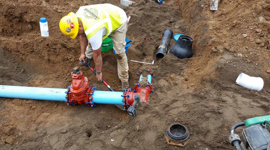 man working with pipe